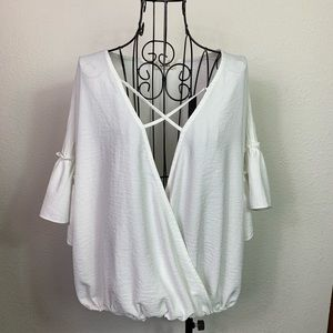 Adora blouse. Crossover front with sewn bottom